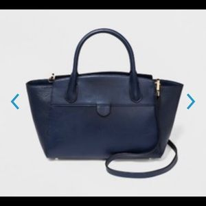A New Day Winged Satchel in Navy!